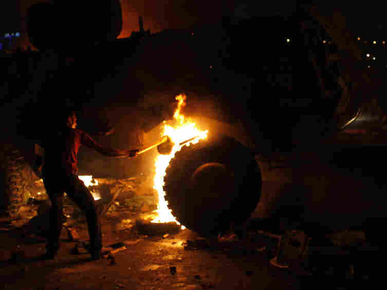 A Coptic Egyptian demonstrator sets on fire an army vehicle during clashes with Egyptian army soldiers following a demonstration in Cairo on Sunday.