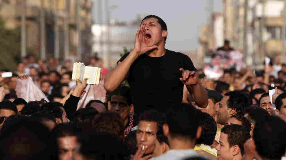 Christians protest outside St. Mark's Cathedral in Cairo, a day after 25 people, mostly Christians, died in clashes with Egyptian security forces.