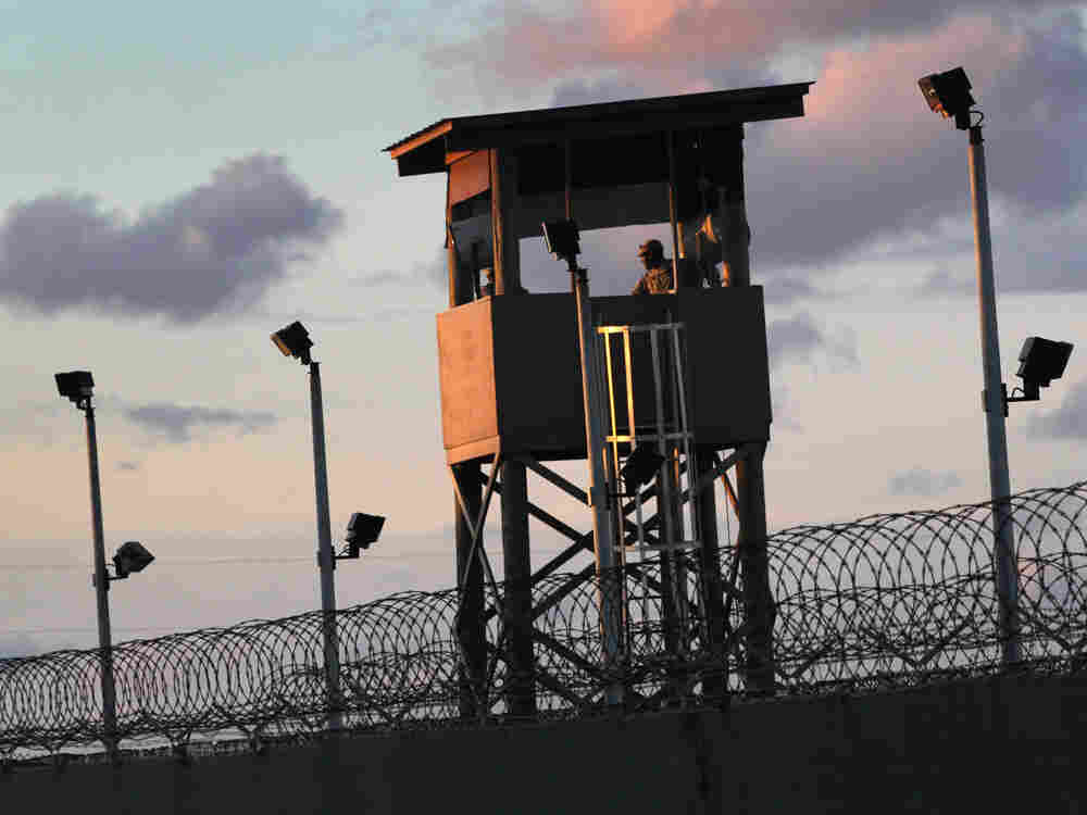 "A U.S. military guard tower stands on the perimeter of a detainee camp at the U.S. detention center for ""enemy combatants"" on September 16, 2010 in Guantanamo Bay."