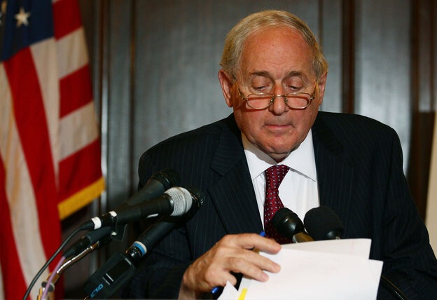 Senate Armed Services Chairman Carl Levin (D-MI), looks at his papers while talking about U.S. companies recieving large tax breaks, during a news confe
