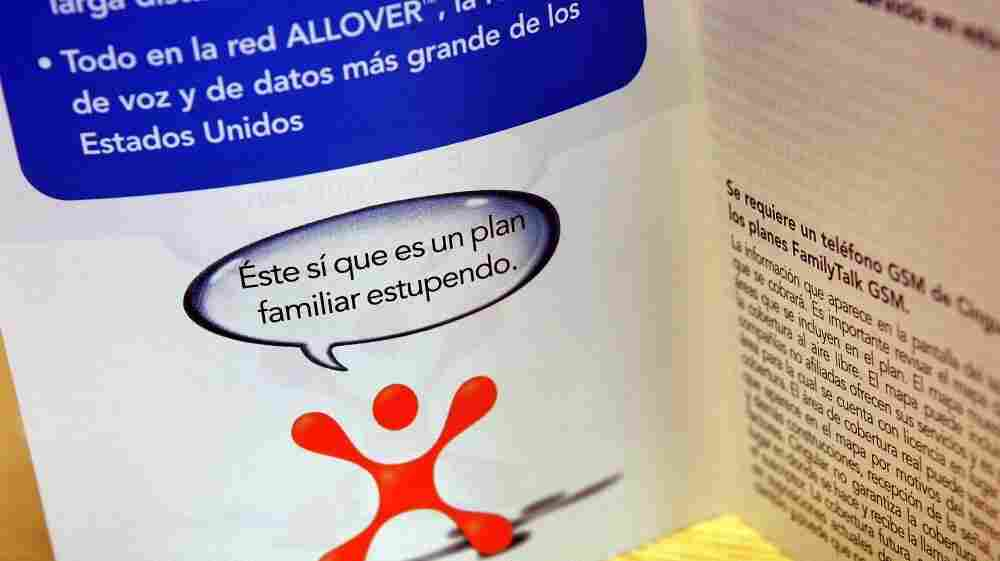 """A Spanish-language pamphlet for Cingular phone-rate information is displayed in a Cingular store in Elmhurst, Ill. Cingular announced in 2006 that it was converting 420 of its stores to """"a bilingual concept,"""" with both English and Spanish phone information and payment options, and bilingual staff members."""