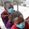 A woman, left, cuts the hair of a fellow tuberculosis patient at a clinic in the township of Khayelitsha, on the outskirts of Cape Town, South Africa, in March.