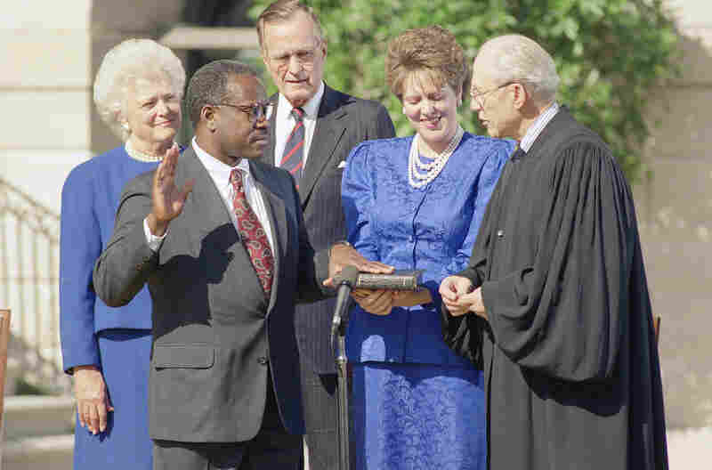 Supreme Court Justice Byron R. White administers the constitutional oath to Thomas in fro