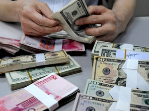 A staff member counts money at a branch of the Bank of China on Aug. 10, 2011 in Lianyungang, Jiangsu Province of China.