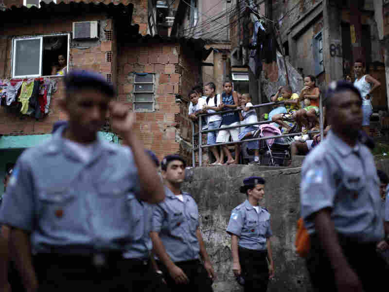 Police officers of the Peacemaker Police Unit program, UPP, patrol the Morro dos Macacos slum last year. The city has stepped up efforts at community policing in order to rid the favelas of drug traffickers.