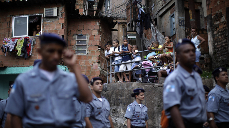 Police officers of the Peacemaker Police Unit program, UPP, patrol the Morro dos Macacos slum last year. The city has stepped up efforts at community policing in order to rid the favelas of drug traffickers. (AP)