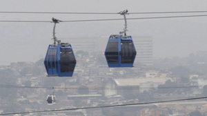 New services and infrastructure for Rio de Janeiro's favelas include cable cars, such as this one in the Complexo de Alemao slum.