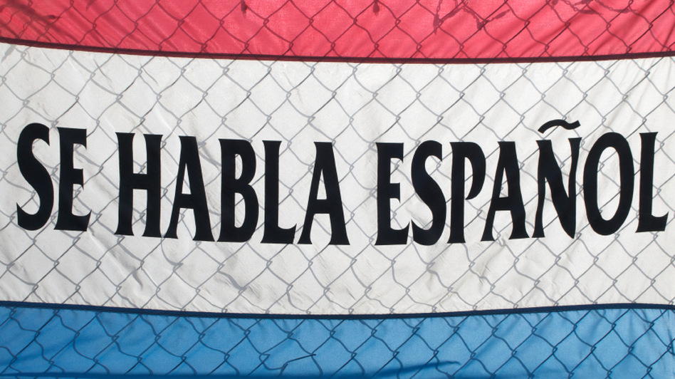 A sign spells out Se Habla Espanol (Spanish Spoken Here).  (iStockphoto.com)