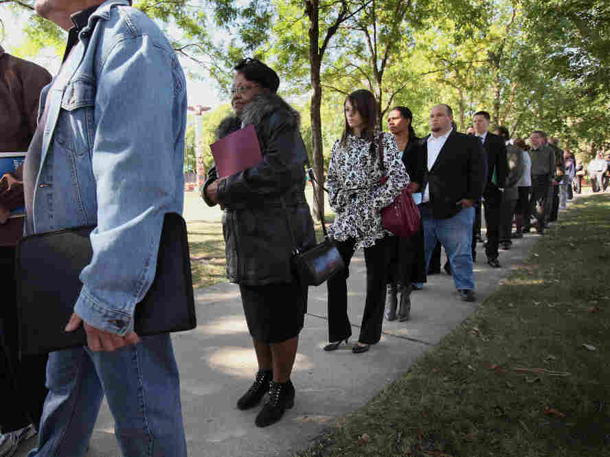 Job seekers waited in line to meet with recruiters at a job fair in Park Ridge, Ill., last month.