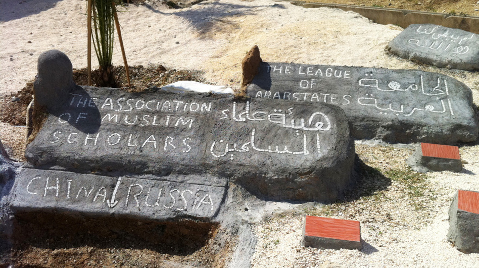 "<p>At the Altinozu camp in southeastern Turkey, the Syrian residents have built a mock graveyard. A freshly dug ""grave"" is for China and Russia, which vetoed a recent U.N. resolution against Syria. Other headstones are for the Arab League and the Association of Muslim Scholars, which have also disappointed the Syrian opposition.</p>"
