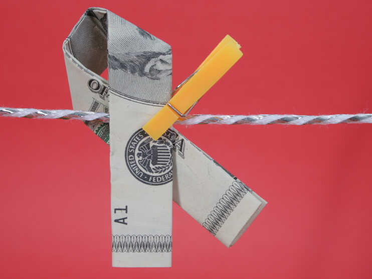 A memorial ribbon fashioned from U.S. currency.