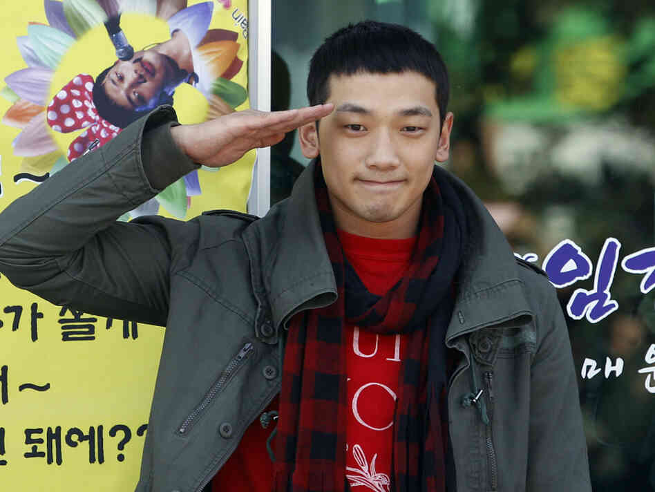 South Korean pop singer Rain gave a military salute to his fans today before entering the army.