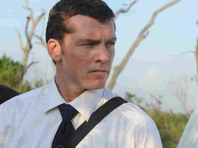 Swamped: Mike Souder (Sam Worthington) is a homicide detective on the trail of two murders — and on the rebound from a collapsed marriage.