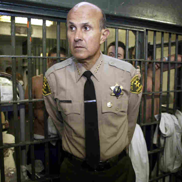 Los Angeles County Sheriff Lee Baca leads a tour inside the men's central jail at the Twin Towers Correctional Facility in Los Angeles in 2004. Baca is accused of ignoring inmate abuse by his deputies.