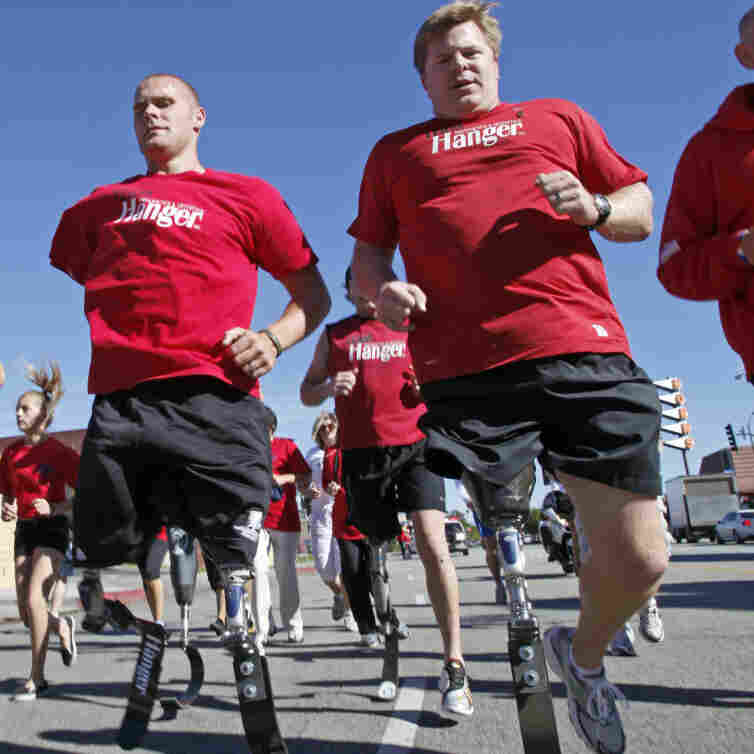 Military members who lost their limbs overseas participate in a run in California.