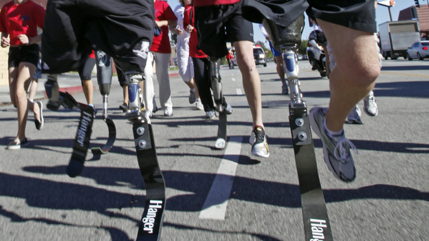 Military members who lost their limbs overseas participate in a run in California.  (AP)