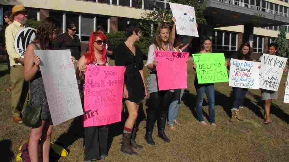 Tuesday, protesters gathered outside the Shawnee County Courthouse over a decision by District Attorney Chad Taylor to stop pursuing domestic violence and other misdemeanor cases.