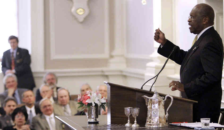 Herman Cain addresses lawmakers at the statehouse in Concord, N.H., Wednesday, Oct. 12, 2011.