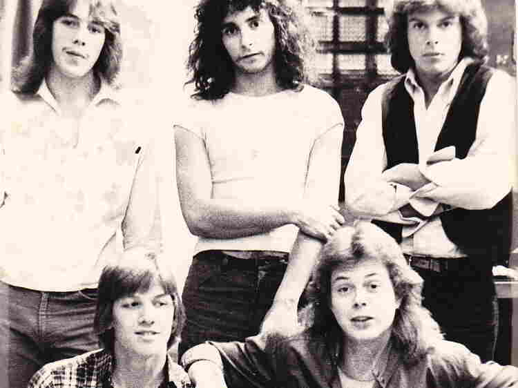 With shaggy hair and skinny jeans, Jon Huntsman (upper right) strikes a pose with his band, Wizard.