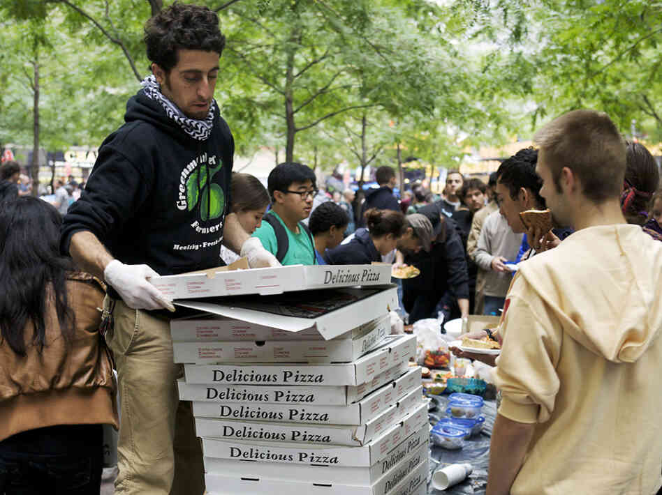 Donated pizzas are handed out in Zuccotti Park for the Occupy Wall Street protesters.