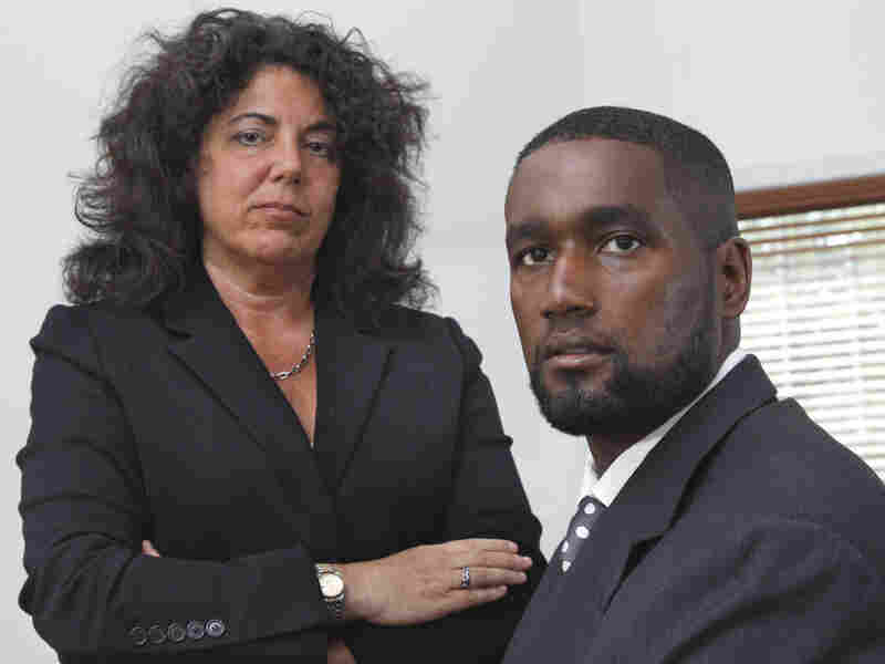 Albert Florence (right) sits at his home in Bordentown, N.J., on Tuesday with his attorney Susan Chana Lask. He challenged his strip search after a wrongful arrest on minor charges.
