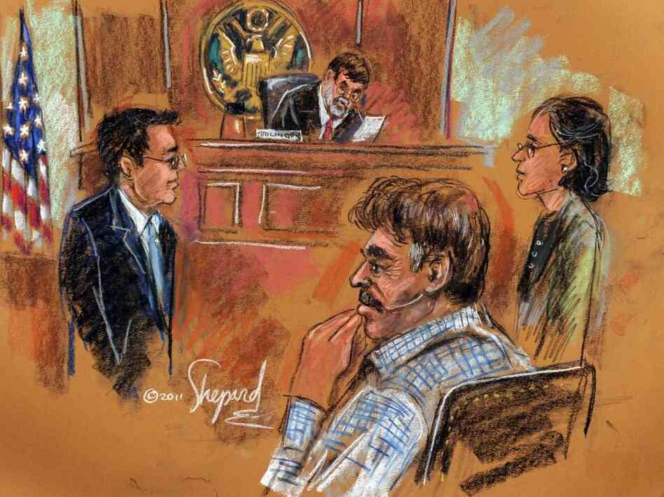 This courtroom drawing shows Manssor Arbabsiar (front, right), appearing before U.S. Southern District Court Judge Michael H. Dolinger on Tuesday.
