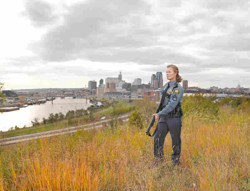 "Anita, St. Paul, Minn., Glock .40-caliber & Remington 11-81 Police Model. ""I was pushing middle age the first time I held a gun. I wasn't raised around hunters and the only other cop in my family history was my great-great-grandfather. He was a cop in New York City and I imagine he carried nothing but a nightstick."""