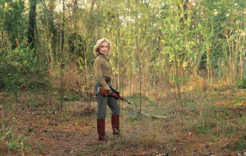 "Lynn, Houston, Texas, Sako .308 bolt-action rifle with scope. ""I think my philosophy of hunting has always been about the adventure itself. ... At the North Pole we stayed in an ice house. ... Pulled by dog sleds during the day, at night we slept in sleeping bags on top of several layers of blankets and sealskins on the ice."""