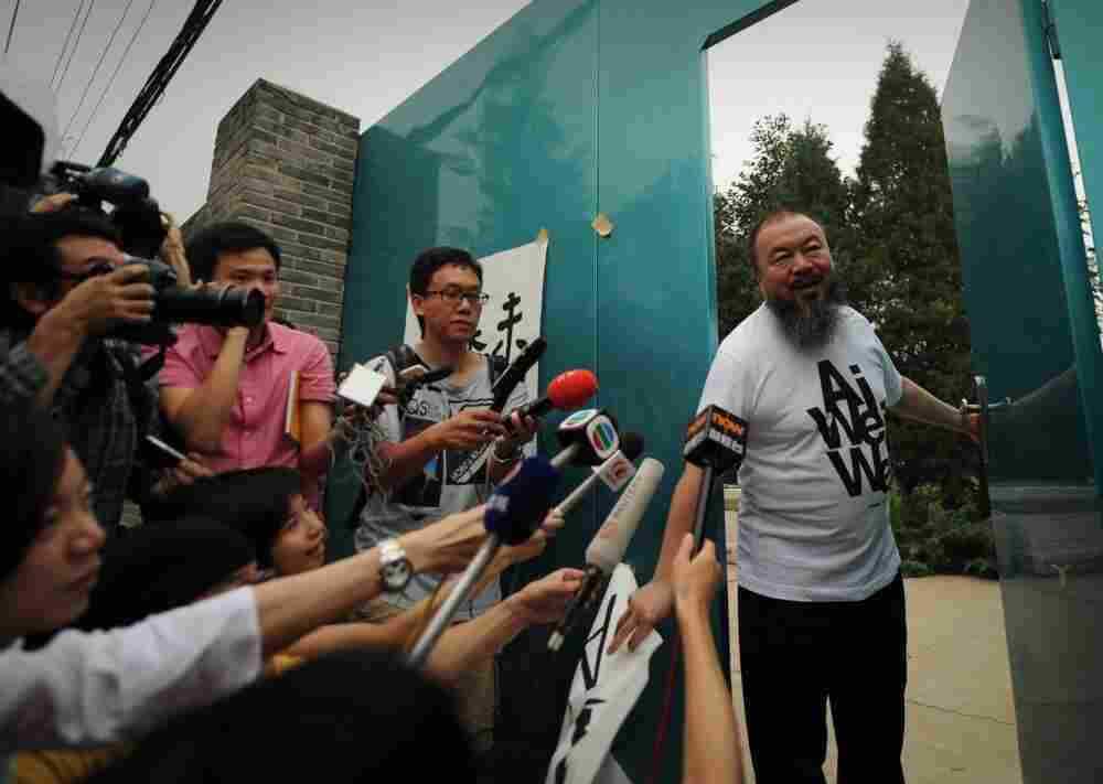 Outspoken Chinese artist Ai Weiwei arrives to speak to reporters outside his studio in Beijing in June of 2011.