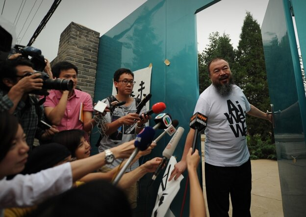 Outspoken Chinese artist Ai Weiwei arrives to speak to report