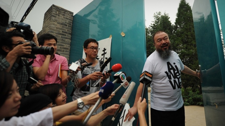Outspoken Chinese artist Ai Weiwei arrives to speak to reporters outside his studio in Beijing in June of 2011. (AFP/Getty Images)