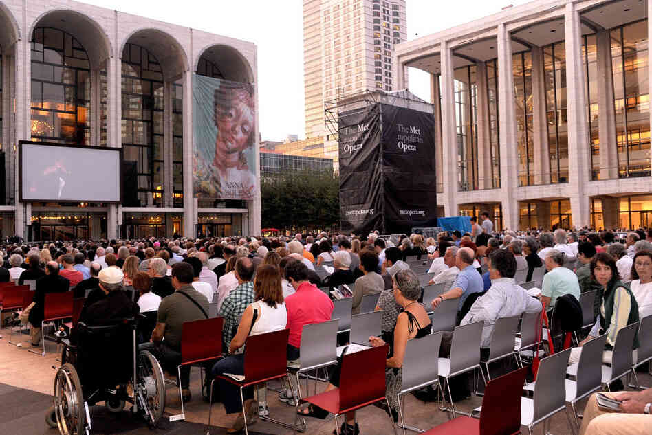 "Opera lovers gather to watch the season opener, ""Anna Bolena,"" for free outside the Metropolitan Opera on Sept. 26, 2011."