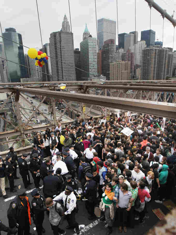 Police arrest two Occupy Wall Street demonstrators after they tried to cross the Brooklyn Bridge on Oct. 1. Media coverage spiked after the incident.