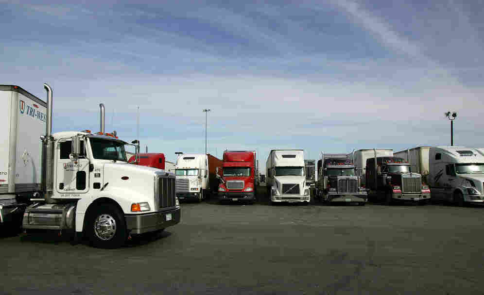 A truck stop near Hesperia, Calif. To address a shortage of truck drivers resulting from a mismatch of skills in the labor market, some trucking companies have started free driving schools with the promise of a job upon completion.