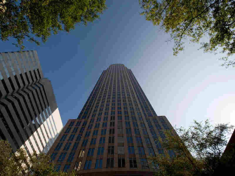 Bank of America's headquarters towers over the city center in Charlotte, N.C. Charlotte has long been one of the fastest-growing regions in the country, but now nearly one in 10 residents is out of work.