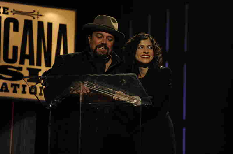 Raul Malo and Carrie Rodriguez announced the winner of the Instrumentalist of the Year award.