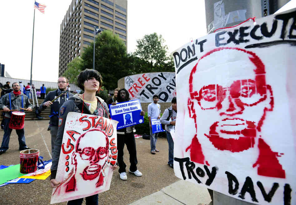Protesters gather outside the building where Georgia Board of Pardons and Paroles members held a hearing for death row inmate Troy Davis in Sept. 2011.
