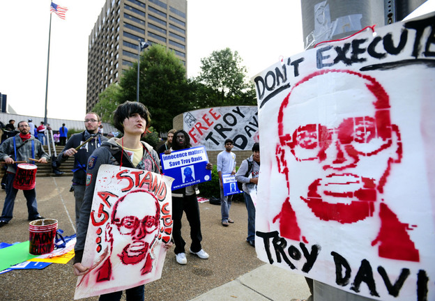 <p>Protesters gather outside the building where Georgia Board of Pardons and Paroles members held a hearing for death row inmate Troy Davis in Sept. 2011. </p>