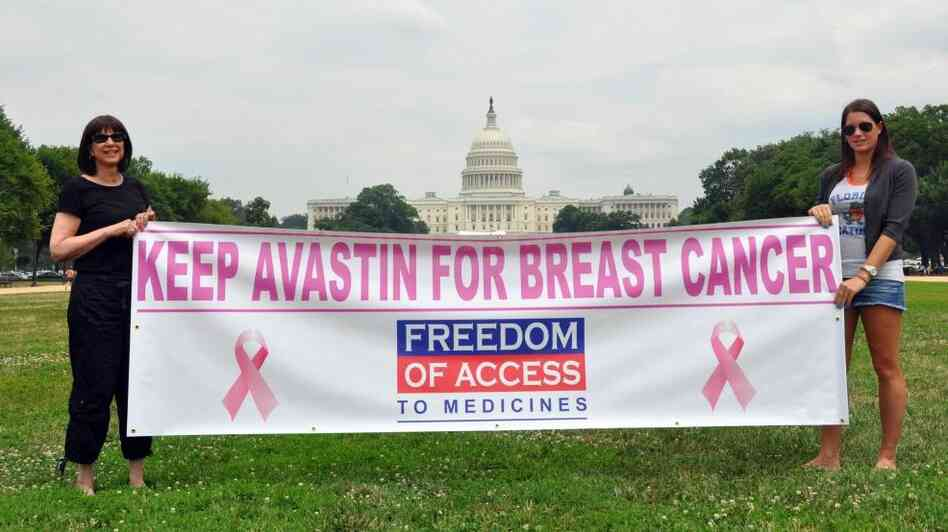 Arlene Kalley and her daughter Leila, who support the use of Avastin for breast cancer, hold a banner outside the National Mall in Washington in June.