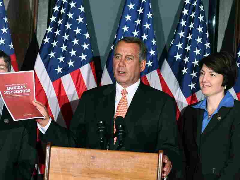 House Speaker John Boehner (R-OH) holds up a booklet as Rep. Chair Cathy McMorris Rodgers (R-WA) looks on during a news conference at RNC headquarters Oct. 12, 2011 in Washington, DC. Speaker Boehner answered questions about President Obama's jobs bill and other issues before Congress.
