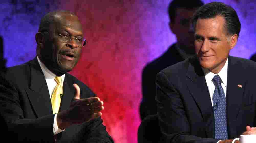 Business executive Herman Cain, left, and former Massachusetts Gov. Mitt Romney during a debate Tuesday (Oct. 11, 2011) in New Hampshire.