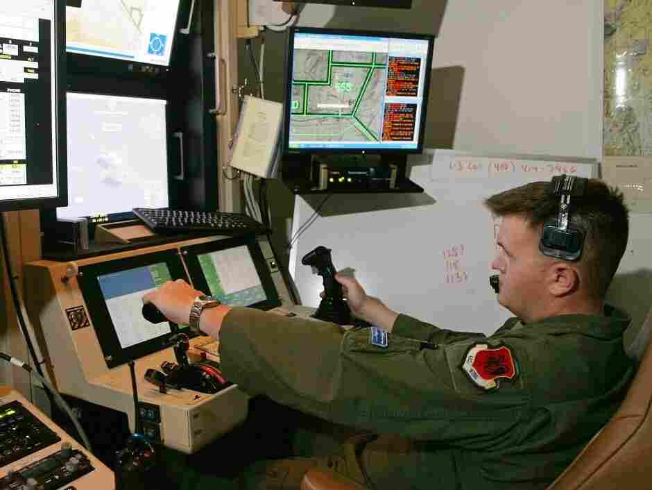 Some of the computers controlling America's fleet of drone aircraft are reportedly infected by a persistent virus. In this file photo, a senior airman remotely operates an MQ-9 Reaper during a training mission at Creech Air Force Base in Indian Springs, Nev.