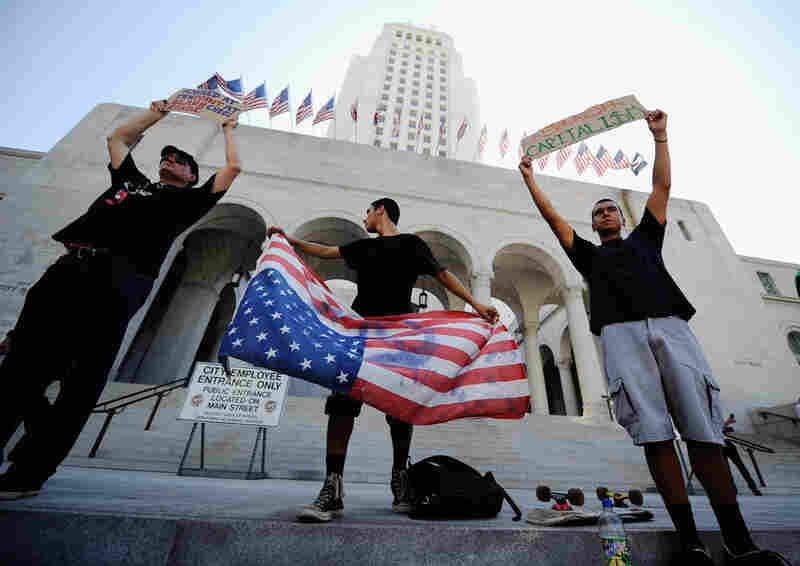In Los Angeles, protesters marched to City Hall during the Occupy Los Angeles demonstration, held to show solidarity with the ongoing protest on Wall Street.
