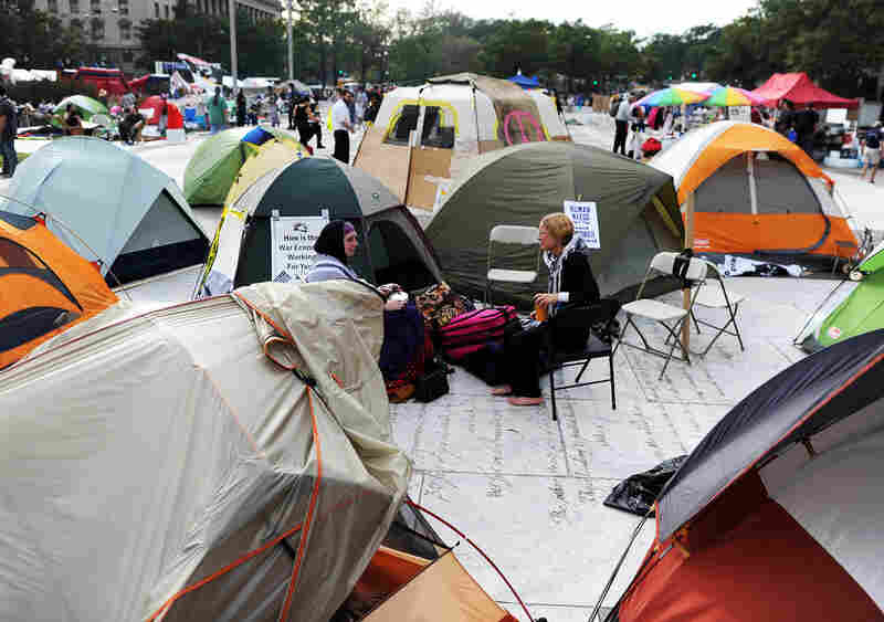 "Protesters sit around their tents during ""Occupy DC"" anti-corporations protest."
