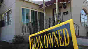 A bank-owned sign is seen in front of a foreclosed home in Miami. Florida was among the hardest hit states in the real estate collapse.