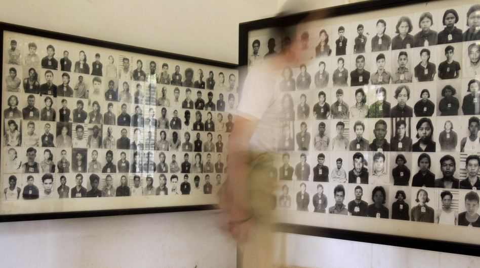 A tourist views photos of former Khmer Rouge prisoners at the Tuol Sleng genocide museum, formerly the regime's notorious S-21 prison, in Phnom Penh, Cambodia, in a photo from 2009.  (AP)