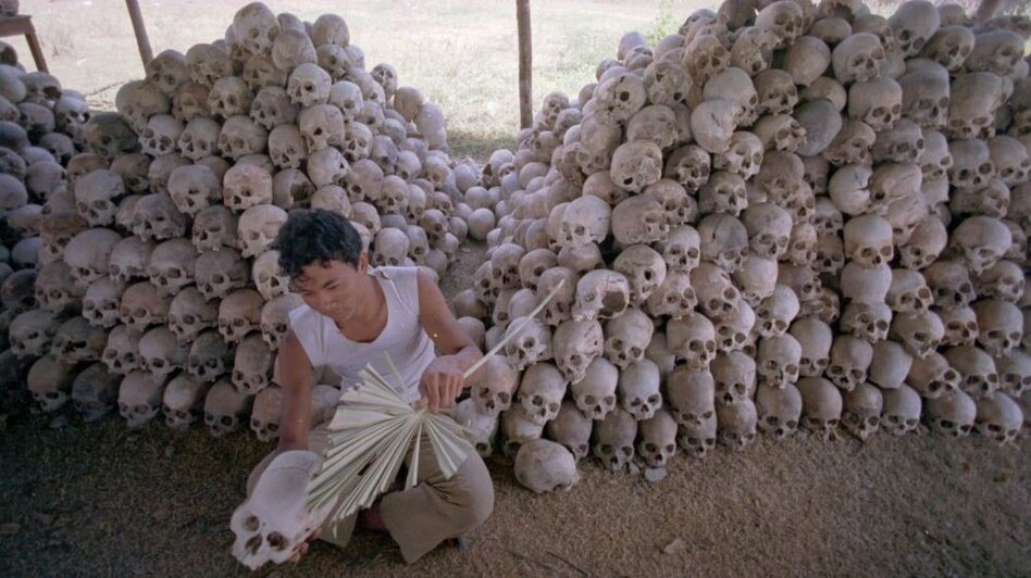 <p>In this undated photo, a man cleans a skull near a mass grave at the Choeung Ek camp outside Phnom Penh, Cambodia — the best known of the killing fields run by the Khmer Rouge in the middle and late 1970s. Now, Cambodians are skeptical that a U.N.-backed tribunal will be able to deliver justice in the case of four remaining high-level Khmer Rouge officials.</p>