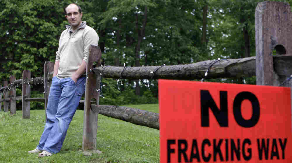 T.J. Turner stands in his yard in Yellow Springs, Ohio, on May 27 near a sign protesting the practice of fracking, a process used to extract oil or natural gas from hard rock formations. Turner was approached by a salesman for an energy exploration company to lease rights for drilling on his property.