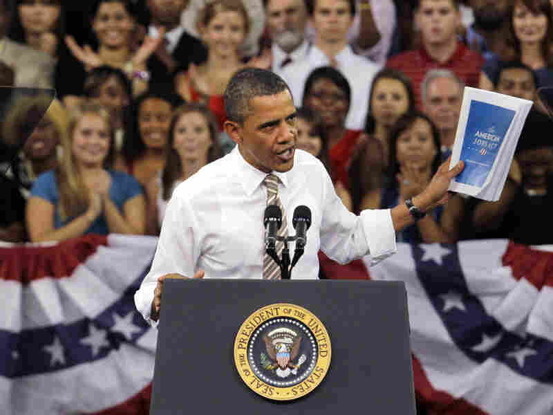 President Obama holds up his jobs bill as he speaks at North Carolina State University in Raleigh, N.C., on Sept. 14. The president returns to North Carolina on Monday to drum up support for his proposals and for his re-election campaign.