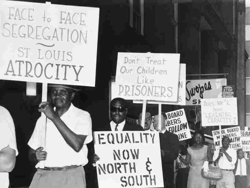 Civil rights groups picketed a meeting of the board of education in downtown St. Louis in June 1963 to protest integration policies in public schools.